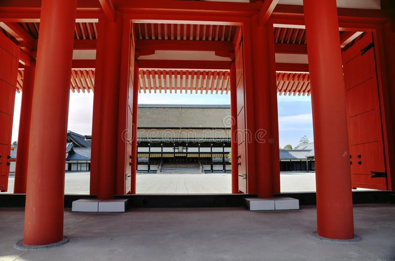 Main gate to Kyoto Imperial Palace. Massive orange pillars of main gate to Japanese Imperial palace in Kyoto royalty free stock photography