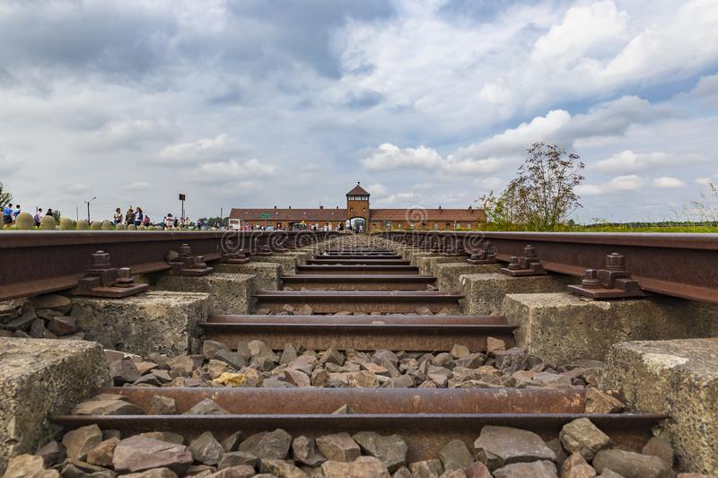Main gate to nazi concentration camp, Auschwitz-Birkenau, Poland. POLAND - AUGUST 2019:Main gate to nazi concentration camp, Auschwitz-Birkenau stock photo