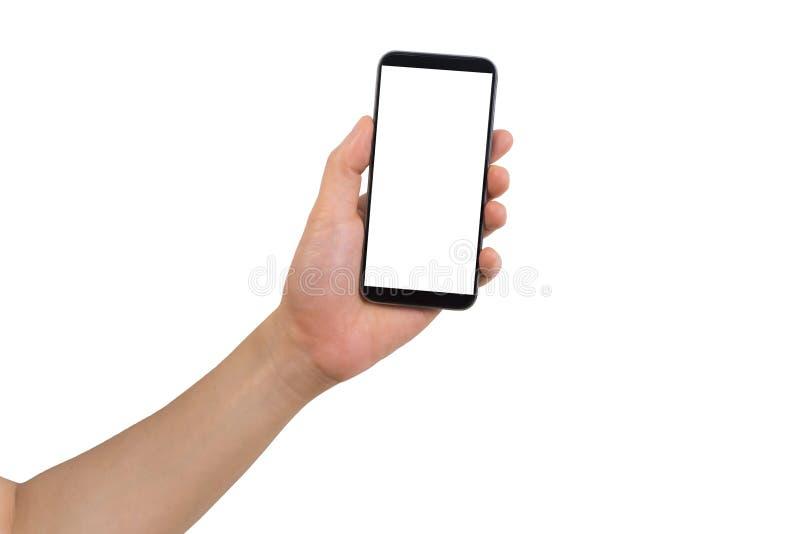 Main gauche tenant le blanc blanc au téléphone portable d'écran photo stock