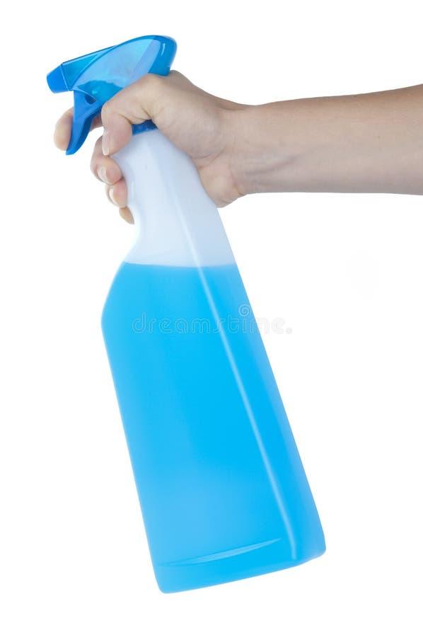 Main injectant une bouteille de jet de nettoyage image libre de droits