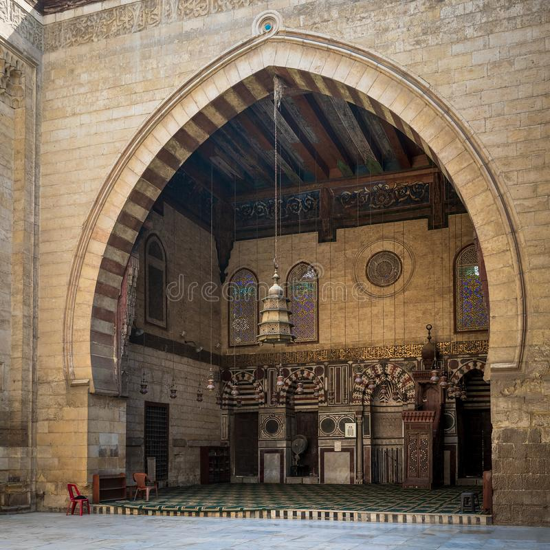 Main iwan - arch - at the courtyard of historic Mamluk era mosque of Al Ashraf Barsbay, Cairo, Egypt. Main iwan - arch - at the courtyard of public historic royalty free stock images