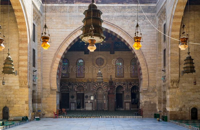 Main iwan - arch - at the courtyard of historic Mamluk era mosque of Al Ashraf Barsbay, Cairo, Egypt. Main iwan - arch - at the courtyard of public historic stock image