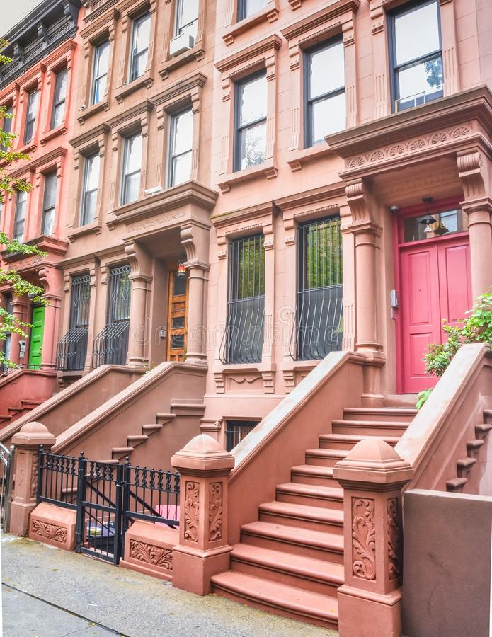 Main ladder and entry door. New york Harlem buildings. Brown houses. NYC, USA stock image