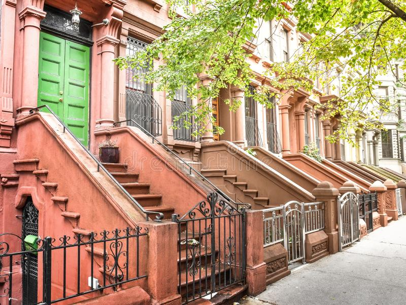 Main ladder and entry door. New york Harlem buildings. Brown houses. NYC, USA stock photo