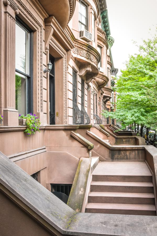 Main ladder and entry door. New york Harlem buildings. Brown houses. NYC, USA royalty free stock photography