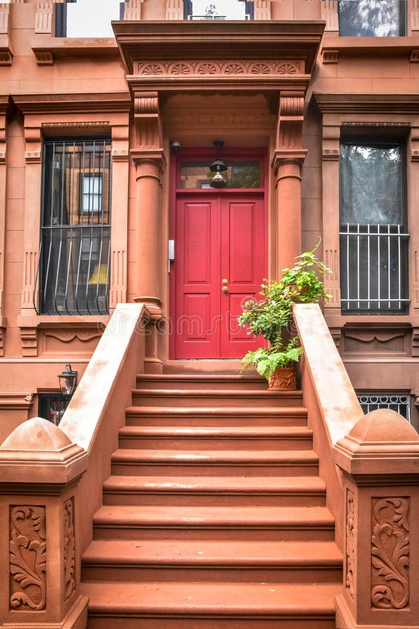 Main ladder and entry door. New york Harlem buildings. Brown houses. NYC, USA royalty free stock photos