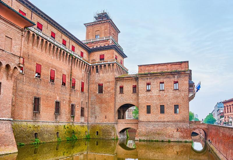 The main landmark of Ferrara, Italy. The castle of the House of Este in Ferrara is a masterpiece of medieval defensive architecture of Italy, that located in the royalty free stock image