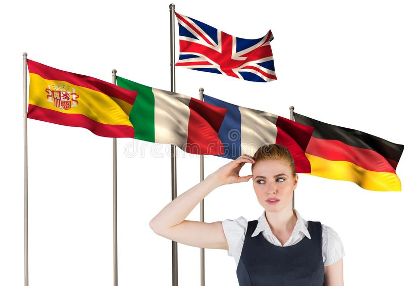 main language flags behind young businesswoman thinking stock image