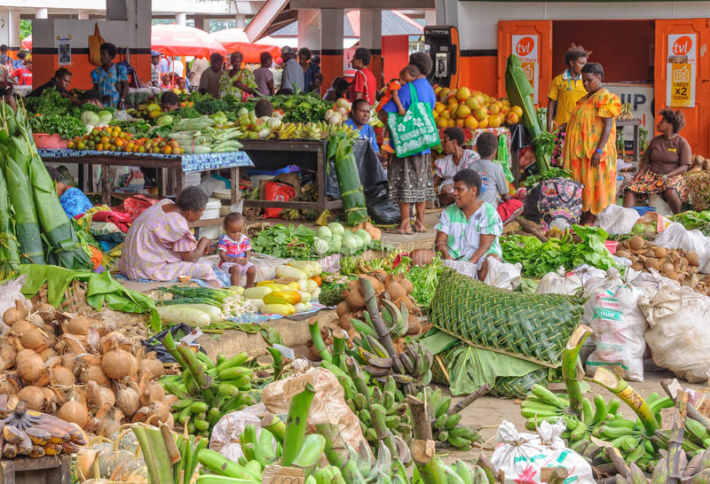 Main Market - Port Vila. Marketeers and shoppers on the colorful covered main market Mama`s Market, which is a open round the clock from Monday morning to stock photo