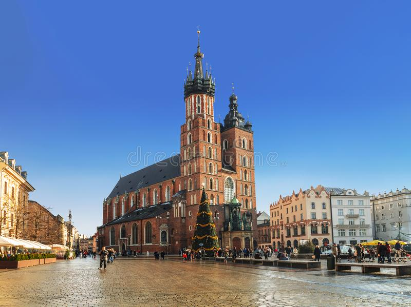 Main Market square in Krakow with St. Mary`s Basilica before Christmas stock photo