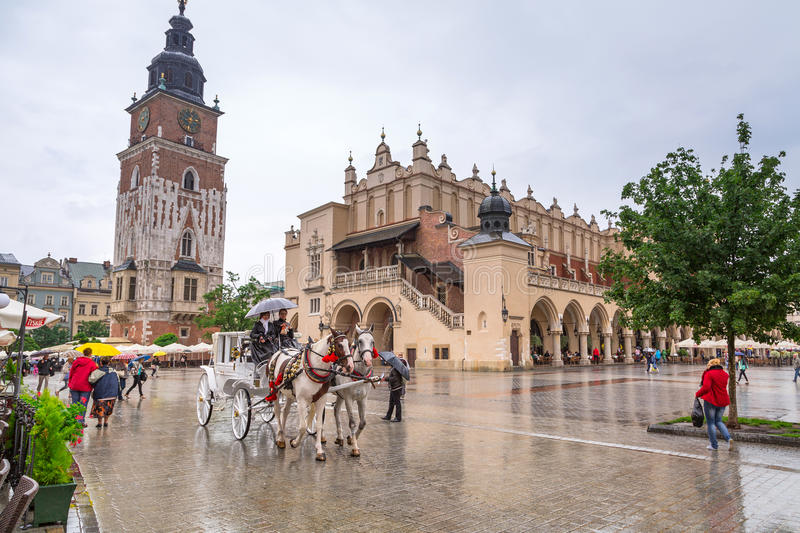 Download Main Market Square Of The Old Town In Krakow, Poland Editorial Stock Photo - Image of clock, building: 32567288