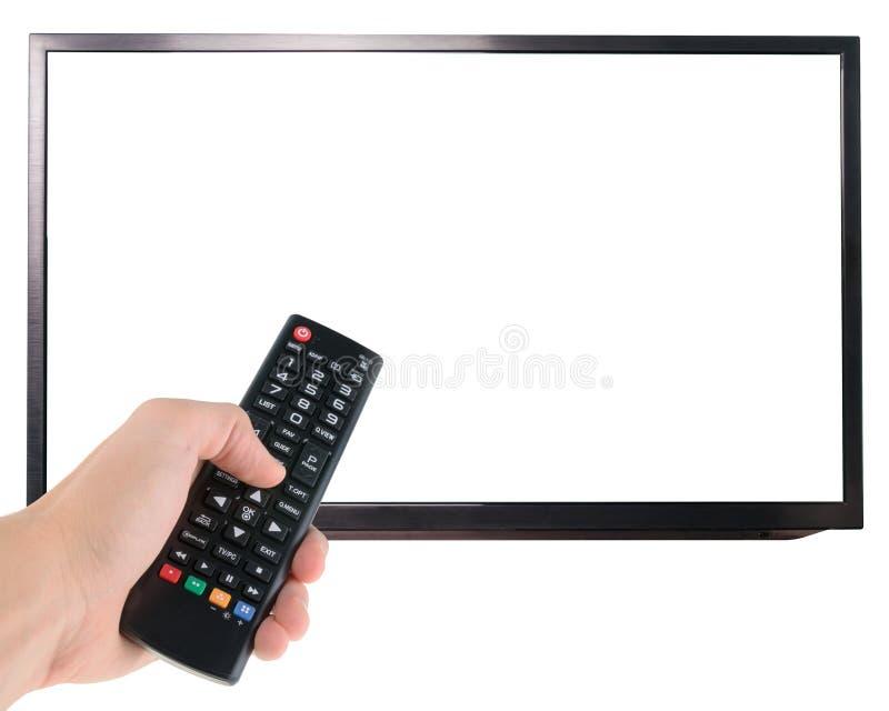 Main masculine jugeant à télécommande à l'écran de TV d'isolement sur le blanc photo stock