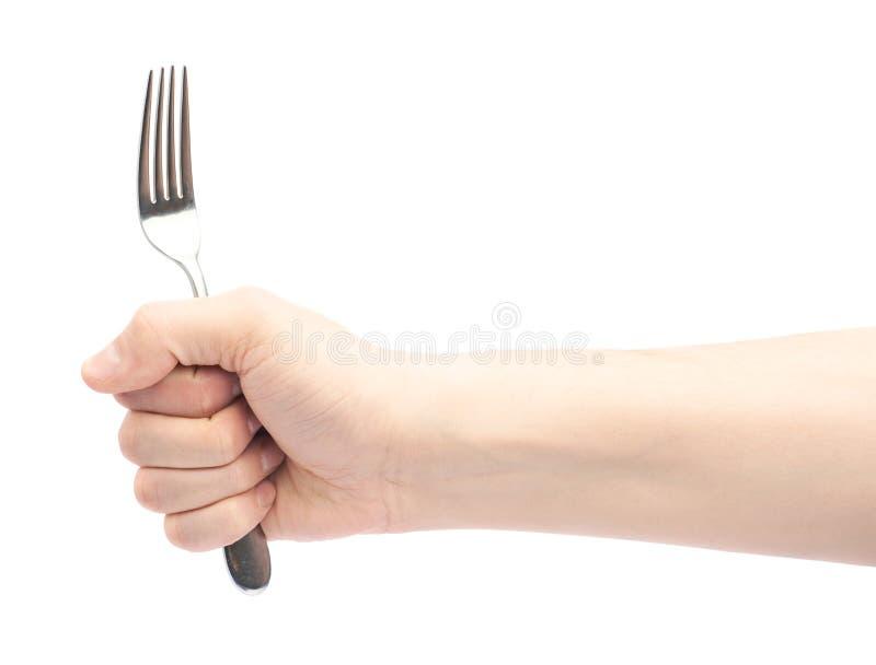 Main masculine tenant la fourchette photos stock