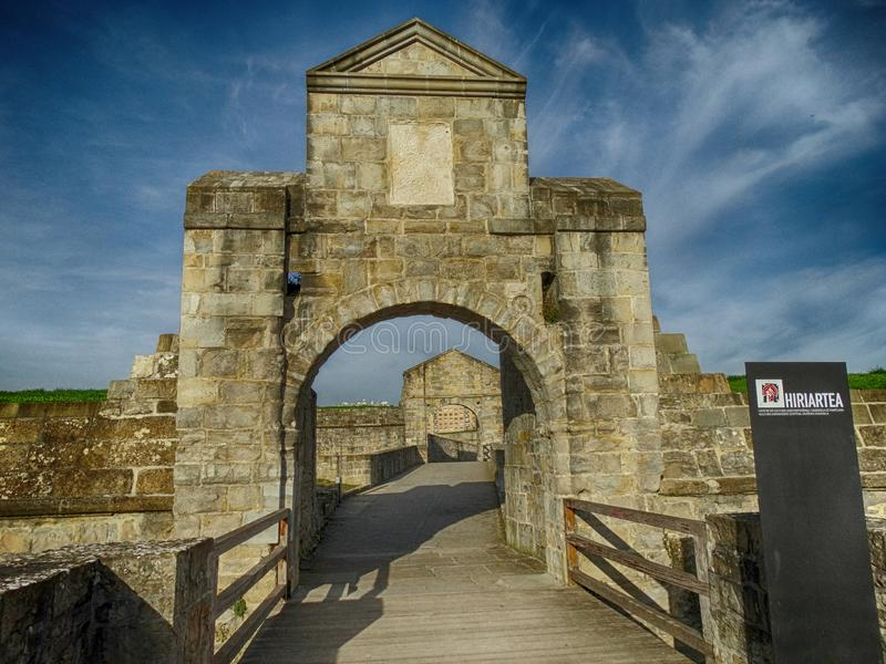 Main Medieval gate, wall and bridge in Pamplona Spain royalty free stock image