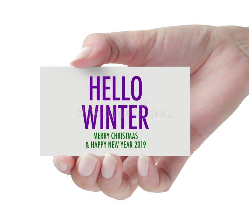 Main montrant l'hiver de bonjour image libre de droits