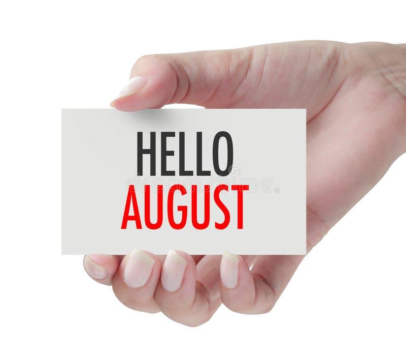 Main montrant le bonjour août photos libres de droits