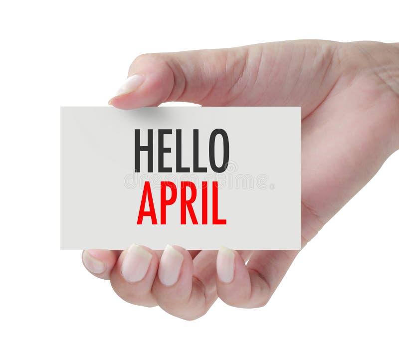 Main montrant le bonjour avril photographie stock
