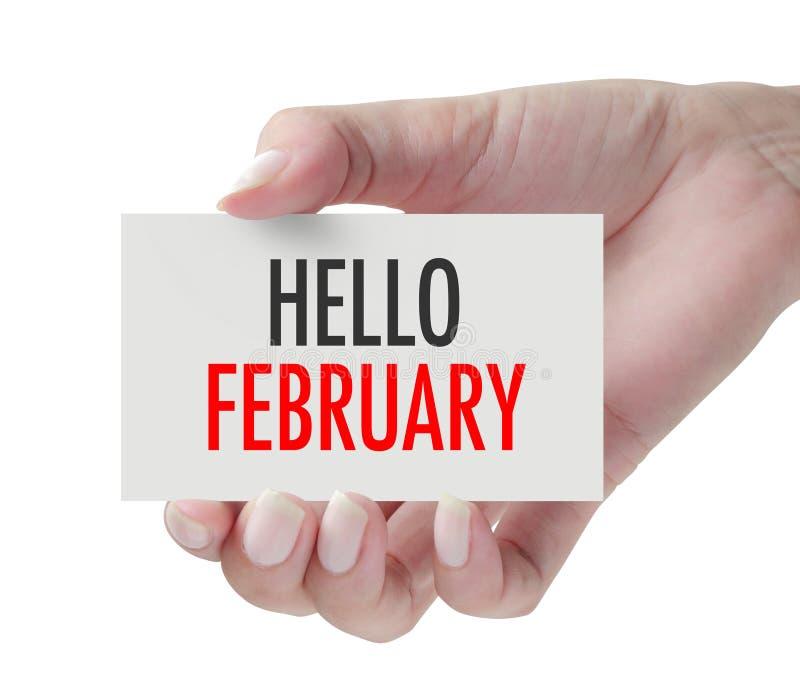 Main montrant le bonjour février photographie stock