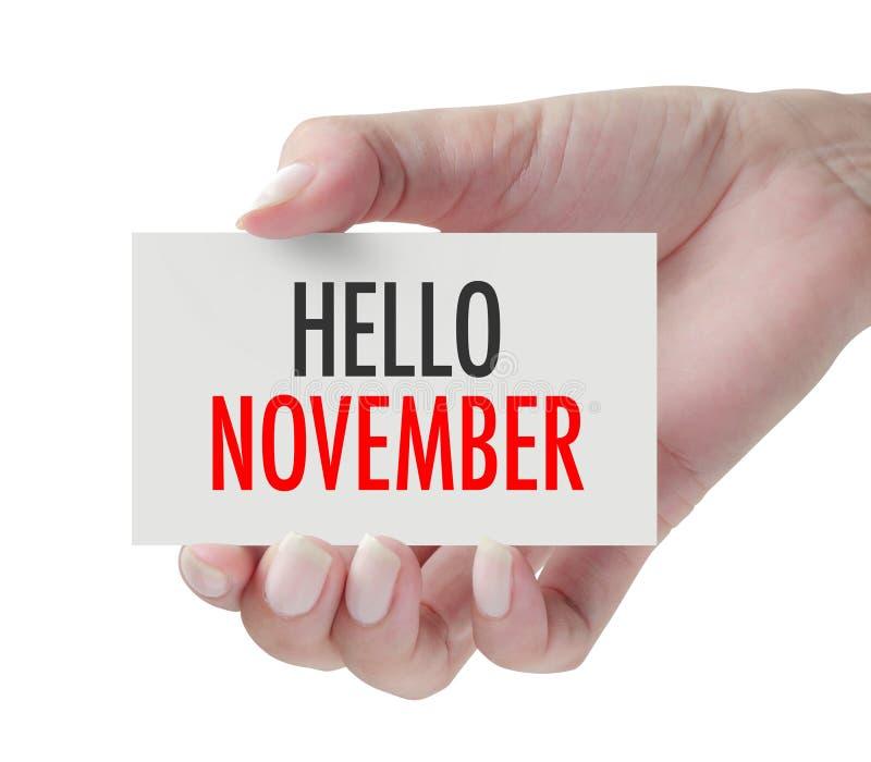 Main montrant le bonjour novembre photos libres de droits