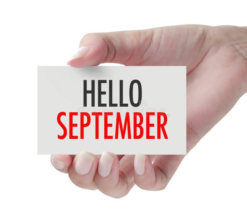 Main montrant le bonjour septembre images stock