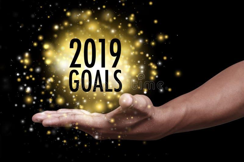 Main montrant les buts 2019 image libre de droits