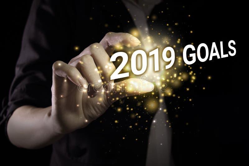 Main montrant les buts 2019 photo libre de droits