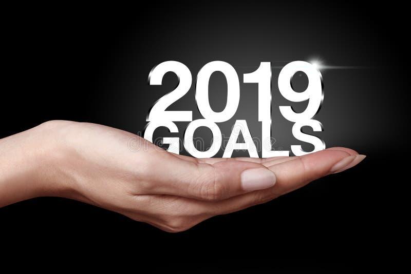 Main montrant les buts 2019 photos libres de droits