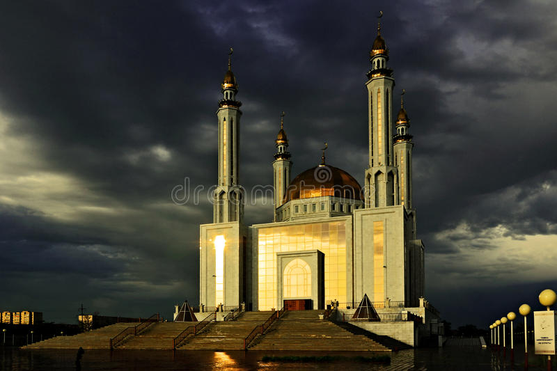 The Main Mosque in Aktobe. (Kazakhstan) at sunrise on the background of an approaching storm stock photography