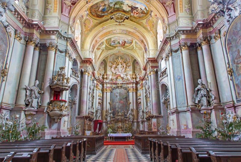 Main nave of baroque church (1745 - 1766) in Premonstratesian cloister in Jasov stock image