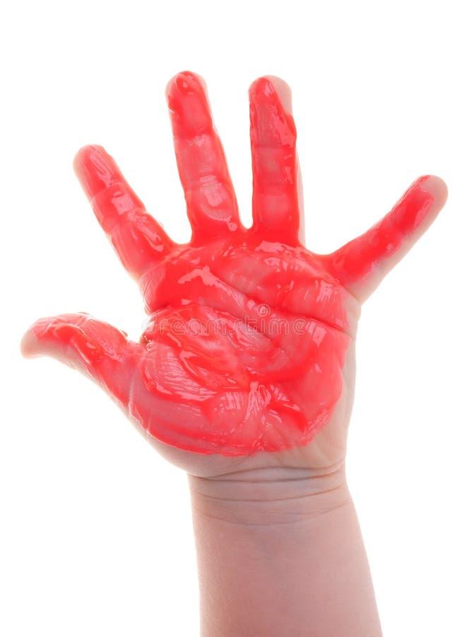 Main peinte d'enfant photo stock