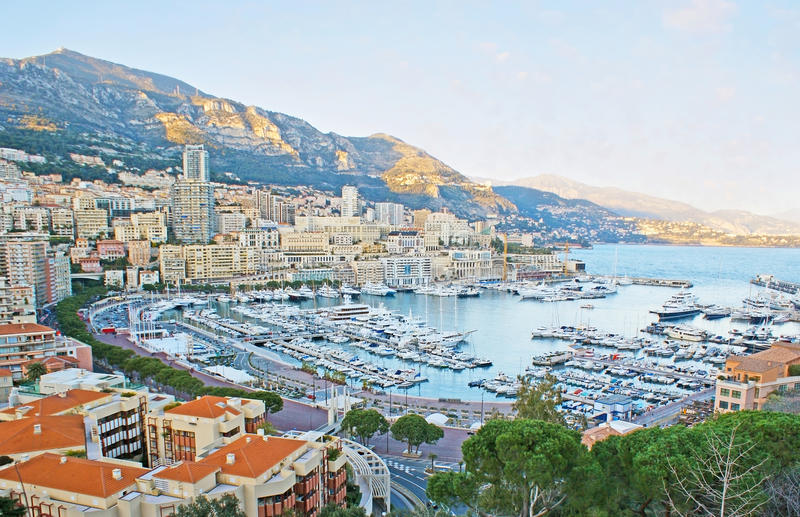 The main port of Monaco. The nice view on the Hercules Port, La Condamine and Monte Carlo wards, surrounded by mountains, from the viewpoint on the Rock of stock photos