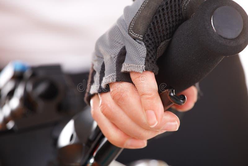 Main poussant le levier de frein image stock