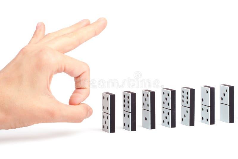 Main prête à pousser des dominos photographie stock
