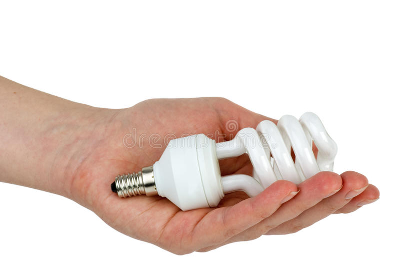 Main retenant la lampe fluorescente compacte images stock
