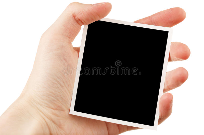 Main retenant la photo blanc photos stock
