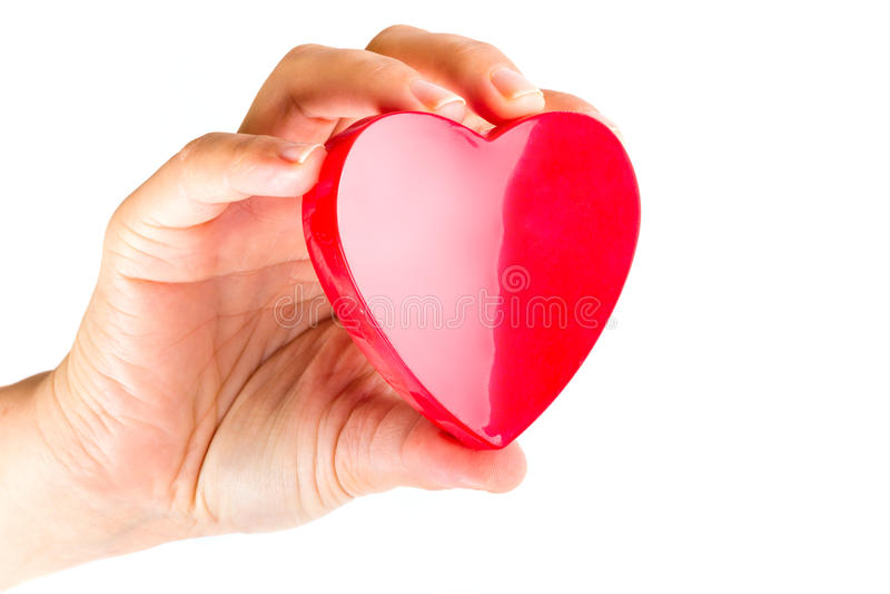Main Retenant Le Coeur Comme Symbole D Amour Image stock