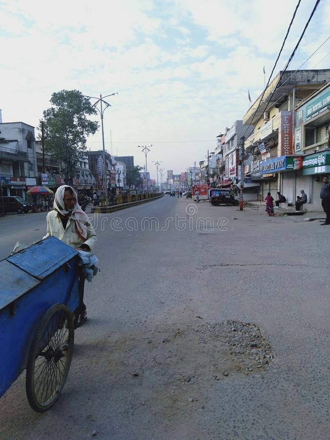Main road of a town sambalpur in the morning. Almost nil vehicles in the road in the morning but after words the road is heavy crowded. Calm and quiet road of stock images