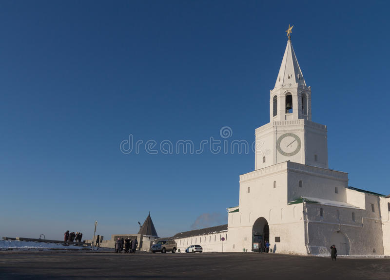 Main Spasskaya tower of Kazan kremlin and main entrance with belfry and big click in early winter morning. royalty free stock photography