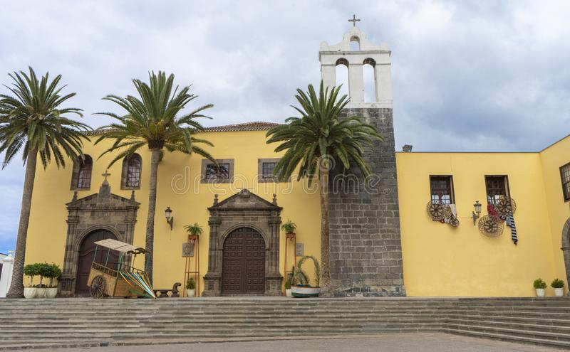 Main Square In Garachico With Monastery Of San Francisco, Tenerife, Spain and folk decoration. Palms in a facade from a historic royalty free stock images