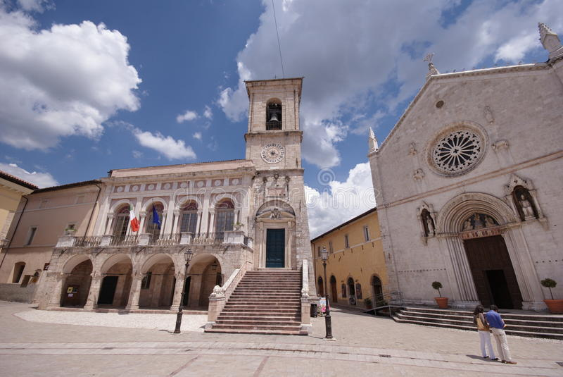 Main square of Norcia, Umbria, Italy. Square of San Benedetto and view over the old St. Benedict church and the city hall building in Norcia medieval town, Italy royalty free stock images