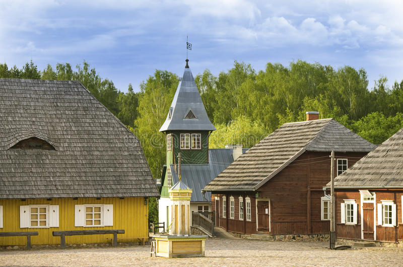 Main square of reconstructed old lithuanian city, a belfry of fire department, supermarket and some other buildings. royalty free stock image