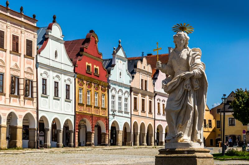 Main square of Telc city, a UNESCO World Heritage Site, on a sunny day with blue sky and clouds, South Moravia. Czech Republic royalty free stock image