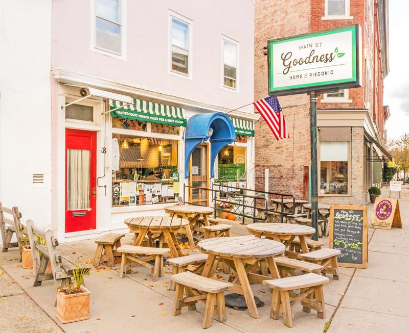Main St Goodness and outdoor dining tables stock images