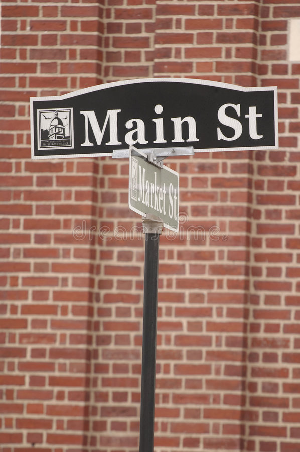 Main St street sign in small town America. Main St street sign infront of brickwall in small town in USA royalty free stock photography