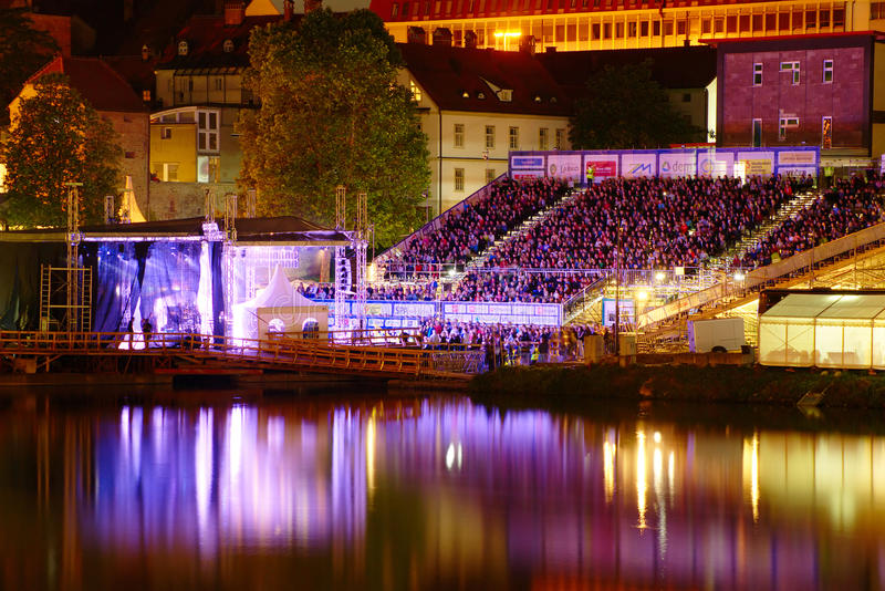 Main stage. Festival Lent. Maribor, Slovenia. Main stage of Festival Lent 2014 full of people during concert with reflections in Drava river in Maribor, Slovenia stock image