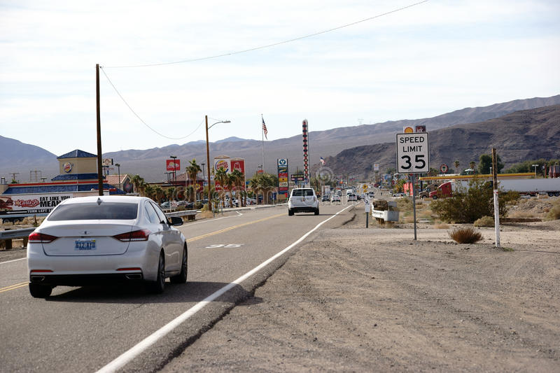 Main Street in Barstow. Barstow, United States - December 22, 2015: Traffic with cars on the main road with gas stations, shops and restaurants on December 22 royalty free stock photography