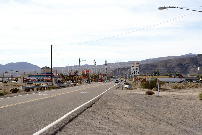 Main Street in Barstow. Barstow, United States - December 22, 2015: Traffic with cars on the main road with gas stations, shops and restaurants on December 22 stock photography