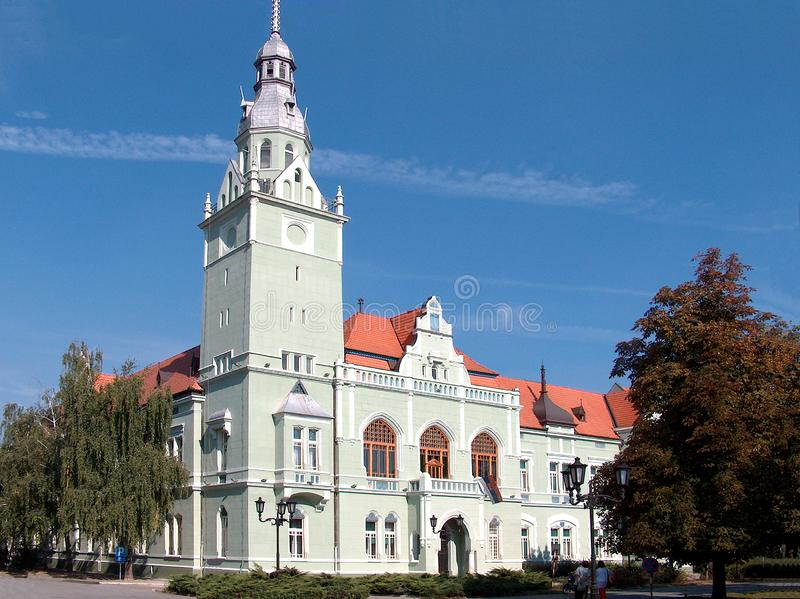 The main street of city of Apatin, Vojvodina, Serbia. View to building of City Hall of Apatin, built in the early 20th century in the style of secession. City stock photography
