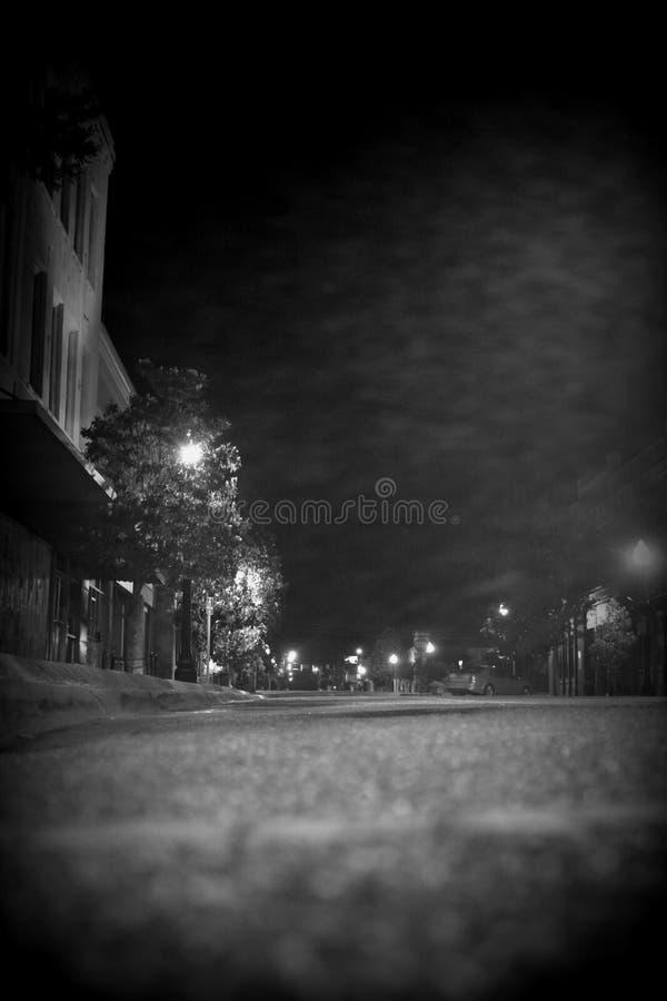 Main Street at night. Buildings, floor, angle, black, white royalty free stock photo