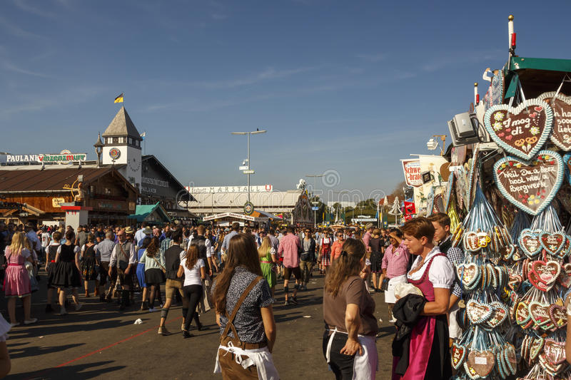 Main street at Oktoberfest in Munich, Germany, 2016. Munich, Germany - September 24, 2016: Main street on Theresienwiese fairground with large beer tents and royalty free stock images